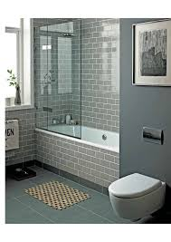 smoke grey glass subway tiles add a spa like feel to this tub