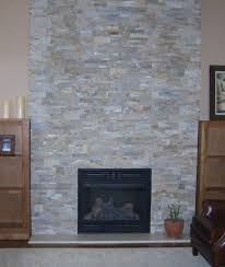 interior simple stone veneer fireplace design featuring wooden