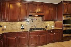 wooden kitchen cabinets used in the kitchen with tumbled marble