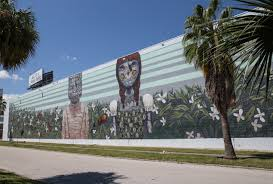 pixel pancho st pete mural tour downtown st pete he specializes in large wall murals and humanoid robots mixed with complex and earth toned patterns that give an ancient feel