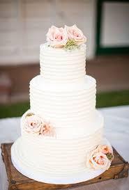 white wedding cake three tiered white cake with pink flowers 2552732 weddbook