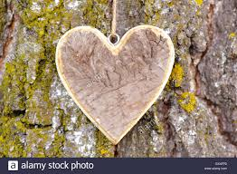 carved wooden heart as symbol for love stock photo royalty free