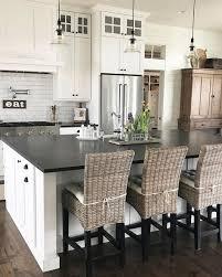 white kitchen island with butcher block top white cabinets black countertops id a butcher block island