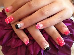 acrylic nails with pocker dot as nail art and 3d bows on ring