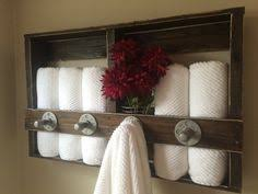 bathroom towel display ideas this bathroom towel decor is simply a sheer green organza ribbon