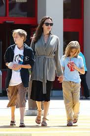 angelina jolie looks every bit the normal mom at target daily