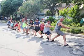 texas videos at abc news video archive at abcnews com photo residents of riverton drive in austin texas participate in a tug of war during one of their annual block parties