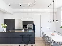 Black Galley Kitchen Flowers Minimalist Dark Kitchen Light Wood Flooring Stainless