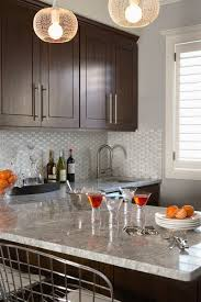 gray walls with stained kitchen cabinets the tile brown kitchen cabinets kitchen design small