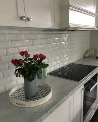 bevelled subway tiles in my classic white and grey kitchen my