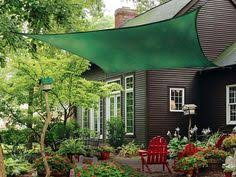 Backyard Shade Sail by A Great Guide To Installing Patio Shade Sails It Covers All The