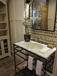 wrought iron vanity bathroom traditional with brick floor marble