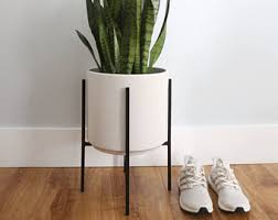 large mid century modern ceramic planter with walnut or oak