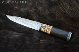 pattern welding gold viking slavic knife with a pattern welded blade and a granate stone