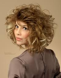 medium long curly hair with wild large curls and a fringe that