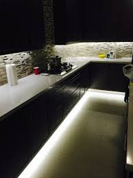 under cabinet lighting tutorial on how to add upper and lower cabinet lighting in the kitchen under cabinet and footwell led strip lighting also