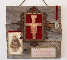 st francis rustic wall art features antique holy card and vintage