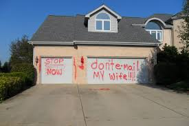 scorned husband gets even by spray painting u0027other man u0027s u0027 garage