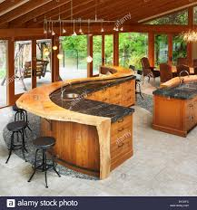 west coast style kitchen with curved wood and marble stock photo