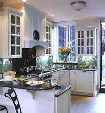 verde peacock granite with white cabinets very pretty kitchen