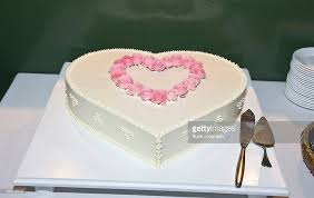 heart shaped wedding cakes heartshaped wedding cake decorated with pink roses stock photo