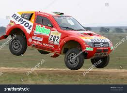 dakar rally winner luc alphand jumping stock photo 11680354
