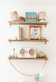 19 ikea hacks for the nursery brit co reclaimed wood and paint ikea shelf brackets to make these elegant bookshelves perfect for lots of shelfies with all those adorable baby accessories