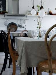 farmhouse style table cloth muslin table cloth with frayed edge thonet chairs ecclectic