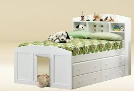 bedroom white wooden bed with storage head and drawer underneath