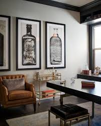 Men Home Decor | a glass and gold bar cart brown leather armchair and oversized