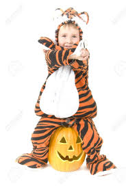 egg halloween costumes toddler in tiger costume sits on pumpkin halloween theme stock