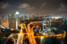 aerial view of singapore with singapore flyer in the right corner
