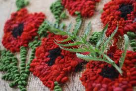 elemental the making of a poppy rug