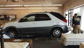 suv crashes through glass storefront at mattress city