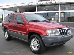dark red jeep 2002 jeep grand cherokee laredo in inferno red tinted pearlcoat
