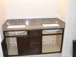 azul platino granite countertop with dark cabinets kitchen ideas