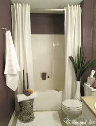 Bathrooms With Shower Curtains Hang A Second Shower Curtain To Make Your Tub Seem Luxurious