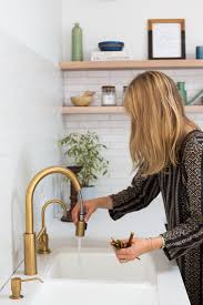 10 easy pieces pull down sprayer faucets remodelista newport brass nb1500 5103 26 east linear pull down kitchen faucet