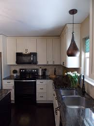 kitchen with cream cabinets and saturnia schist countertops be