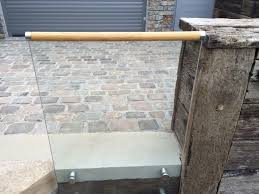 glass balustrade wooden handrail sunrock balconies