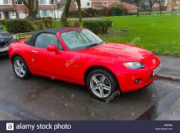 mazda sports car a bright red 2006 registered mazda mx 3 soft top sports car parked