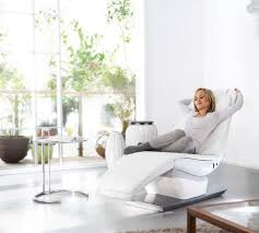 white chaise lounge style recliner chair like a dentist chair