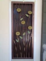 furniture beautiful brown iron door with cool flowers shape