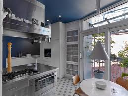 colorful eclectic interior design is collage of travels and memories blue and white kitchen with stainless steel fixtures nonagon style showcasing eclectic interior design