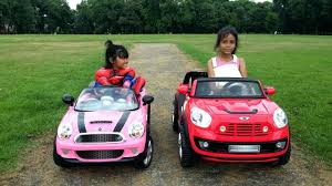 pink mini cooper 12v bmw mini beachcomber vs 6v pink mini cooper race kids ride