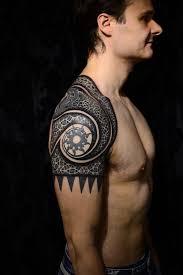black and s geometric shoulder back tattoomagz