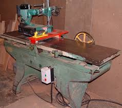 table saw power feeder flattening lumber with a power feeder on the jointer