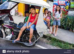 tricycle philippines street children sitting on a tricycle philippines stock photo