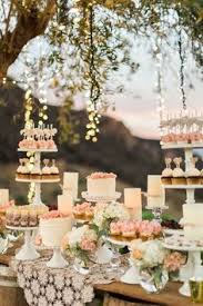 rose gold candy table perfect for outdoor weddings during the warm summer months these