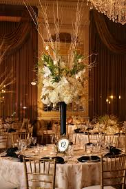 tall centerpiece arrangement with and gold